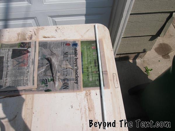 Newspaper and Metal Rod