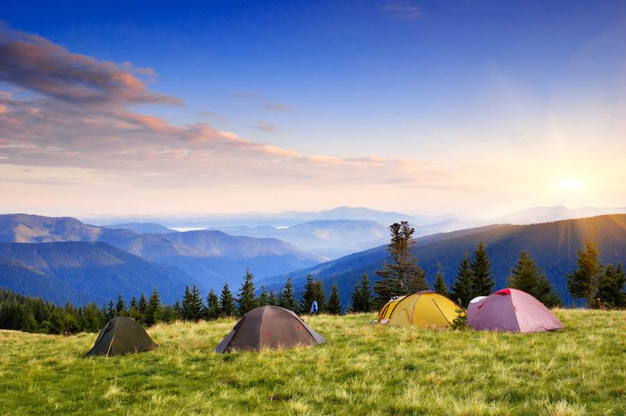 Tent Camping in Meadow with Mountains in Background
