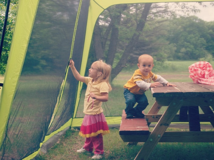 kids playing in a screened-in camping tent