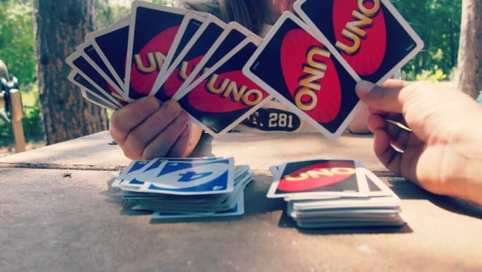 Playing Uno card game while camping.