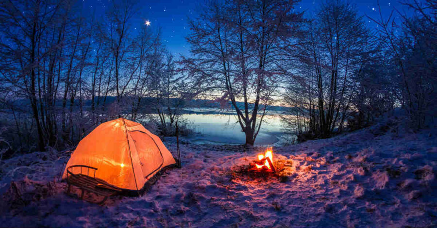 tent camping by campfire at night under the stars