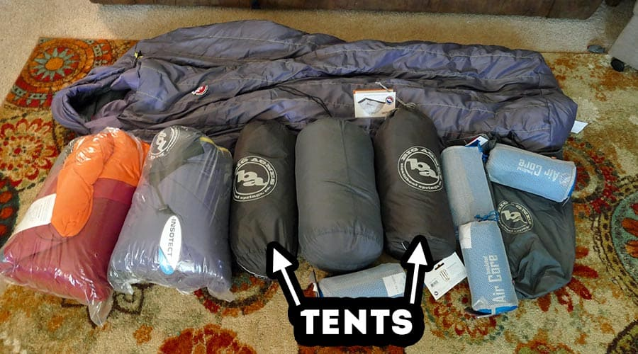 Our Big Agnes Tents, Sleeping Bags and Air Pads laid out in the living room.