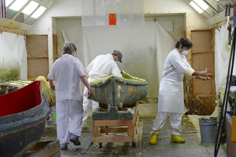 Workers laying sheets of kevlar