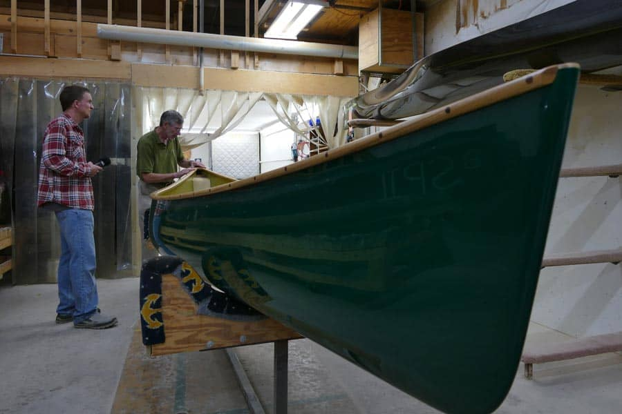 Mike showing the trimming process of the Wenonah canoe.