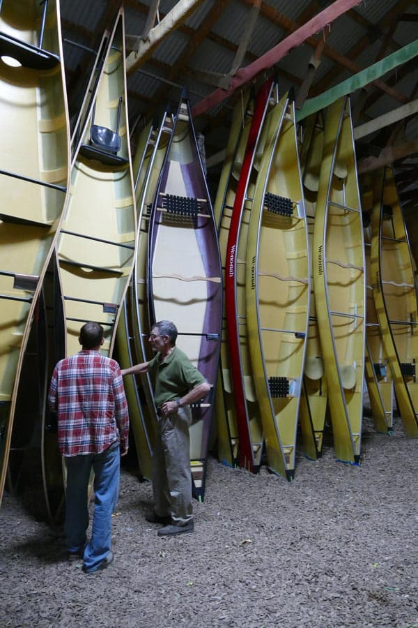 Rows of canoes at the Wenonah Canoe warehouse.