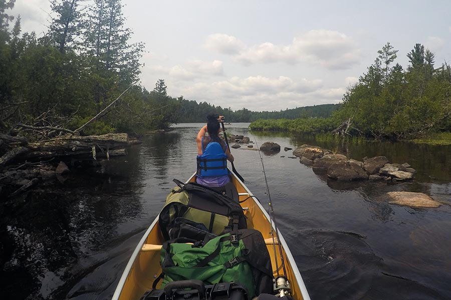 Kelly Paddling With Granite Gear Portage Packs in Canoe
