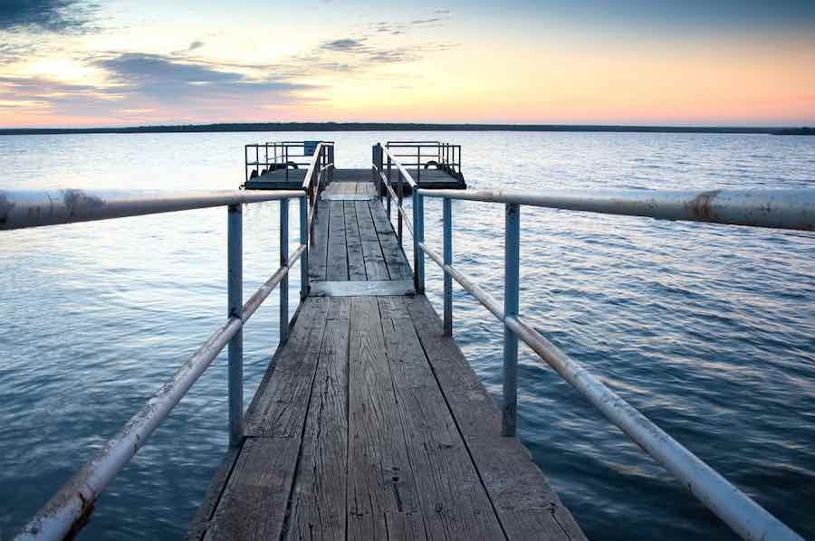 Pier or dock at sunrise or sunset at Millers Creek Reservoir near Munday, Texas.