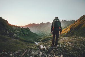 Man Backpacking Into Beautiful Mountain Valley