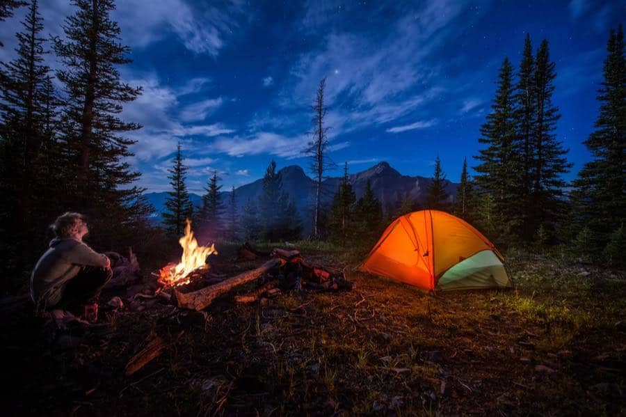 Summer Camping with Campfire and Tent
