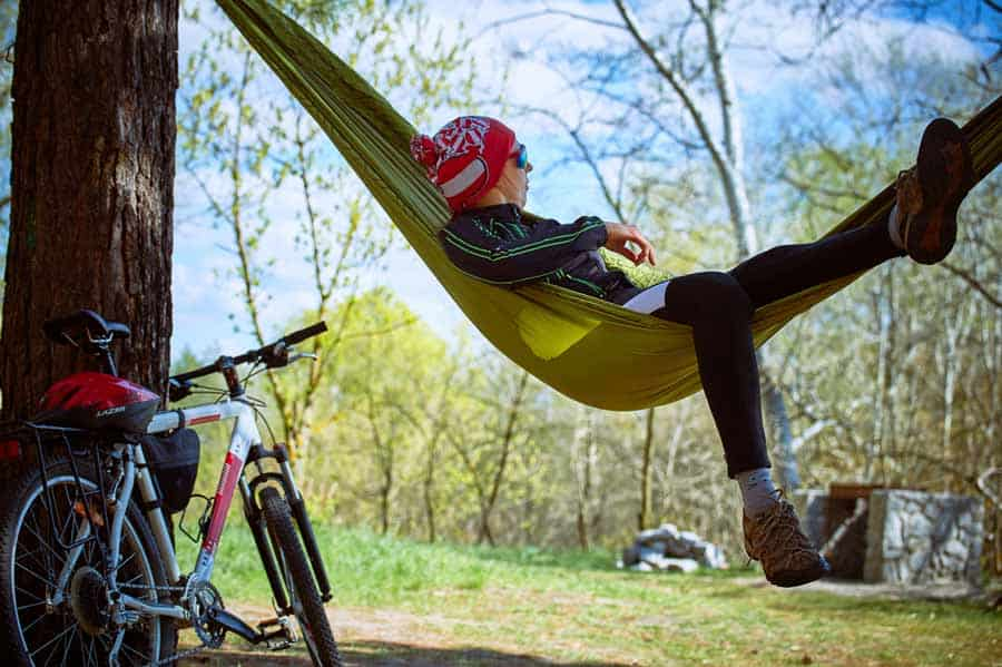 Bicyclist Laying in a Camping Hammock