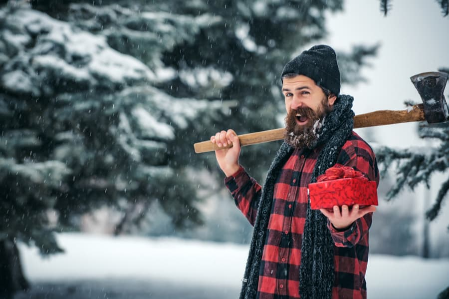 Man Holding Camping Gift and Axe