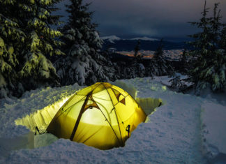 Illuminated Winter Tent in Deep Snow