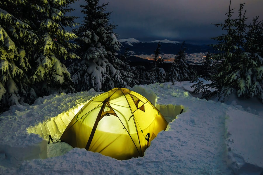 Illuminated Winter Tent in Deep Snow