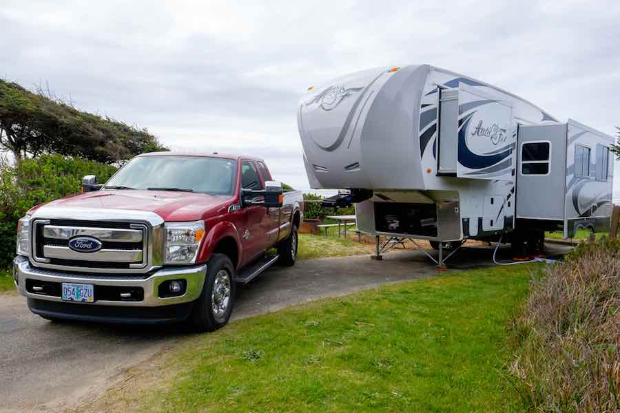 Fifth Wheel Camper being pulled by a red truck