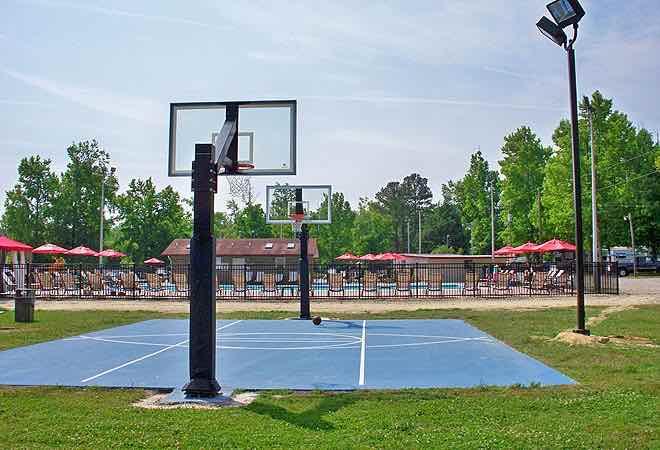 Basketball court and swimming pool at Chesapeake Bay RV Resort