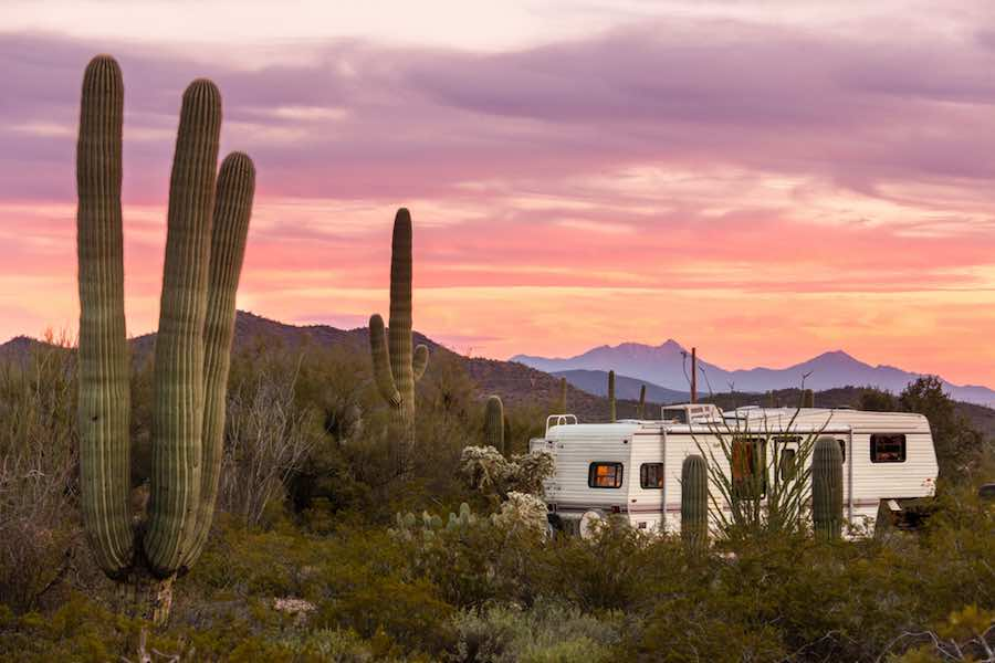 5th Wheel Camper in Arizona desert at sunset with cactus.