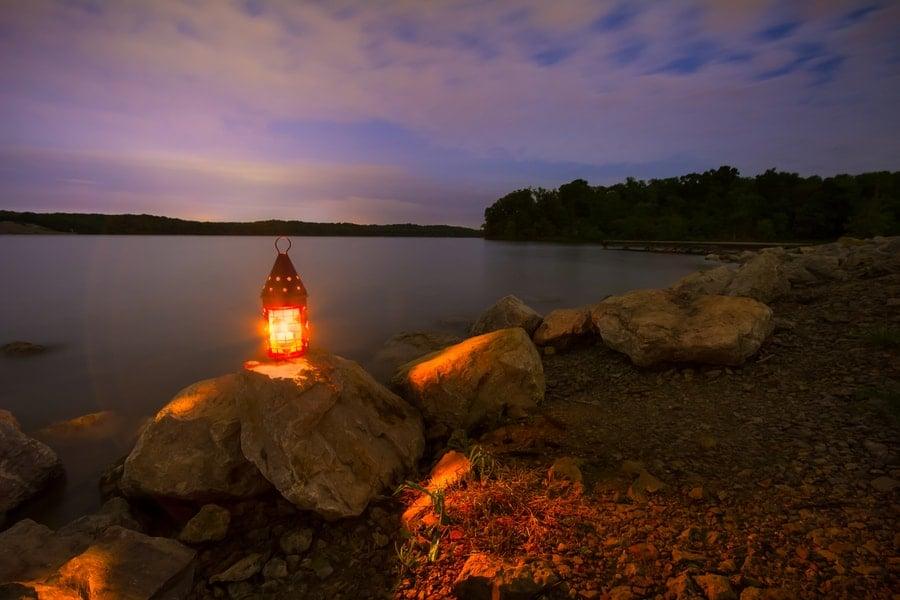 Camping Lantern Near Lake