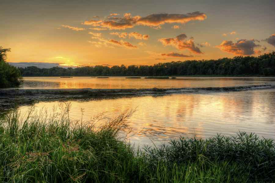 summer sunset at Weir's Rapids on the Maumee river in northwest Ohio