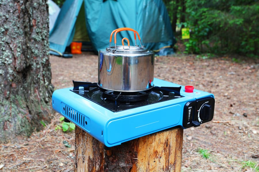Camping stove and coffee pot.