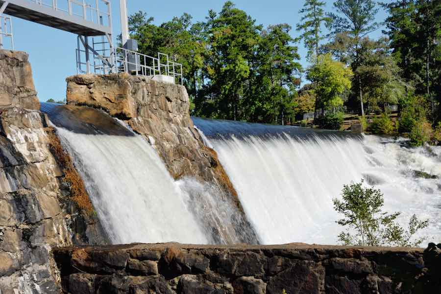 Campgrounds in Georgia: Dam with cascades of water flowing creating beautiful waterfalls at High Falls State Park in Jackson Georgia