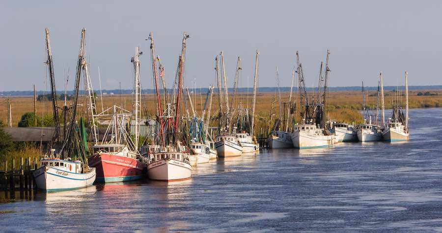 Shrimp boats tied up at a dock along the butler River in Darien
