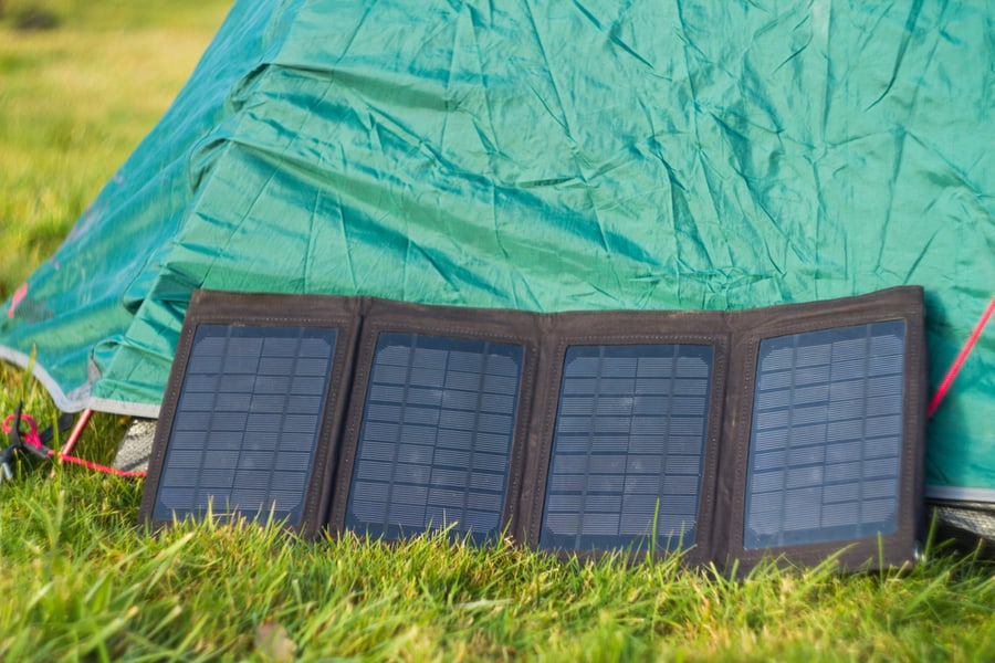 Camping Solar Panels set up along side a tent.