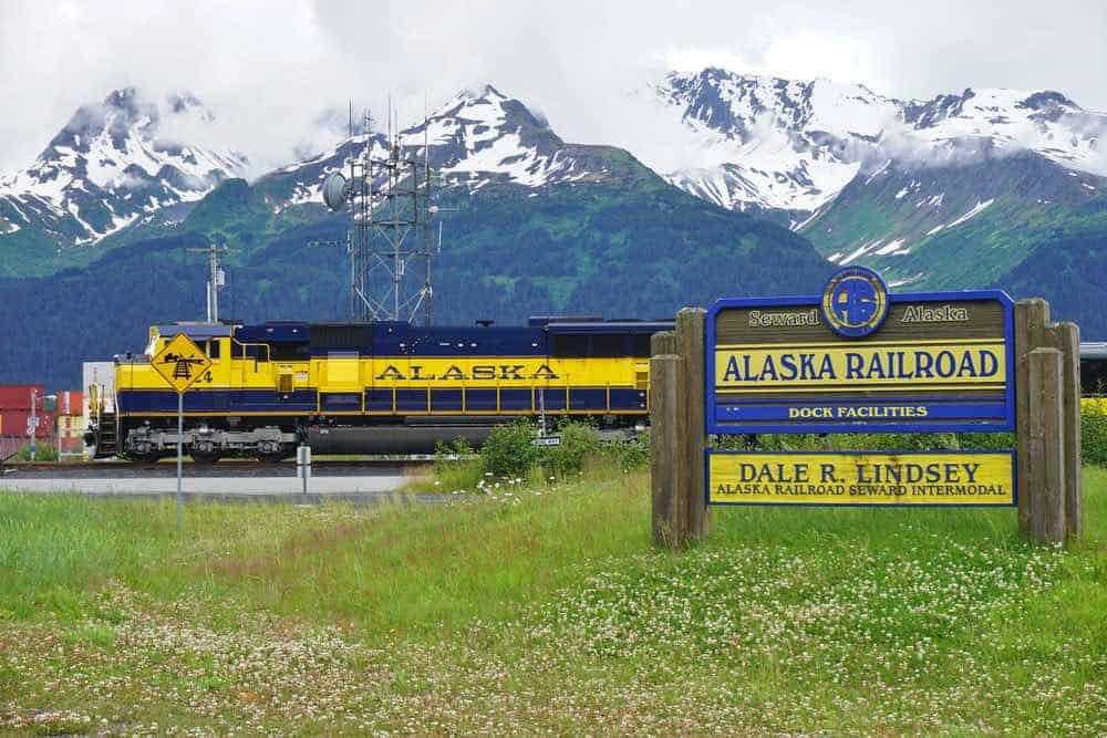 The Alaska Railroad train with mountains in the background