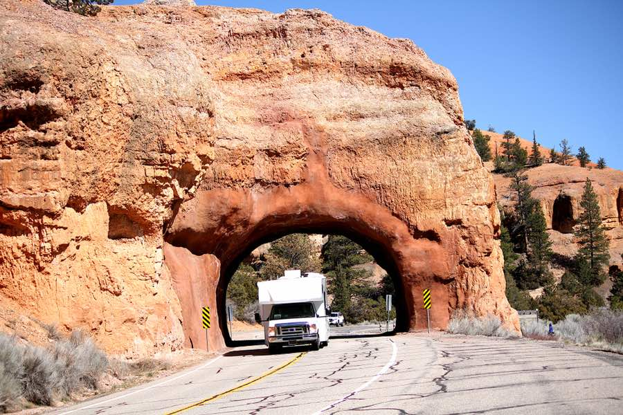 RV Driving Through Rock Tunnel Near Moab in Utah