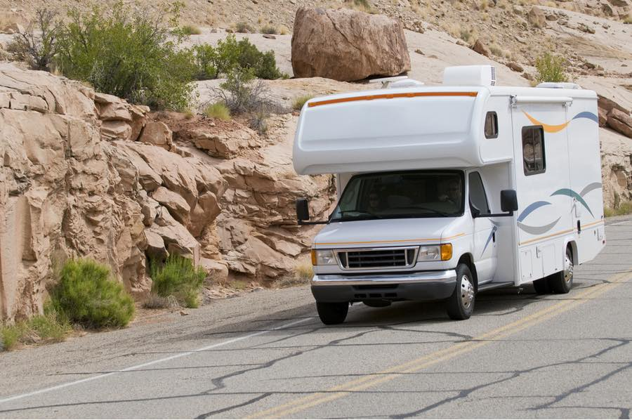 RV Driving Down Scenic Road in Utah