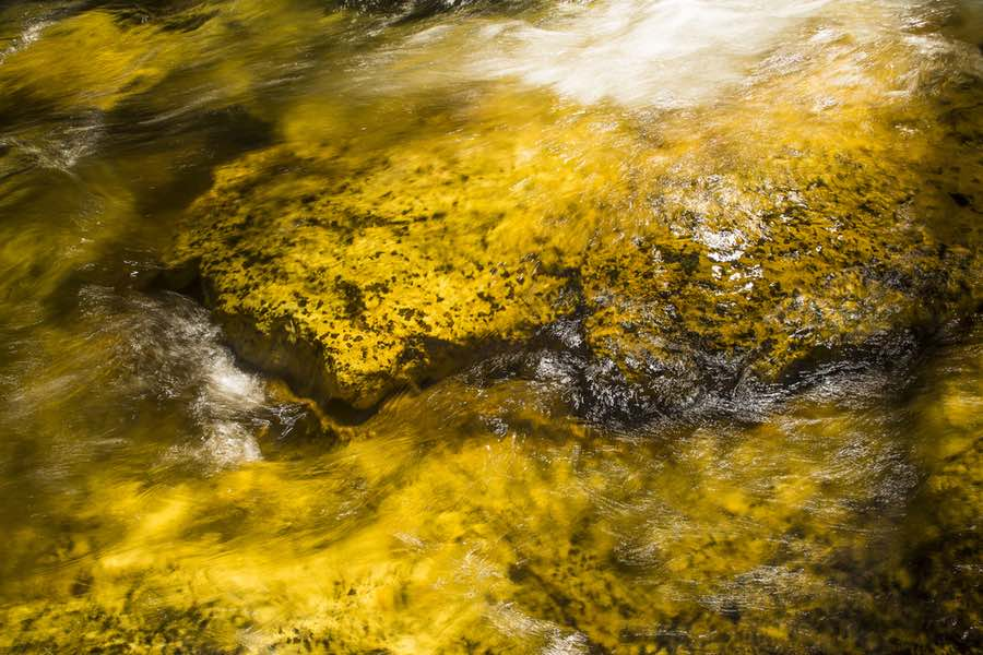 River Water Flowing Over Rock