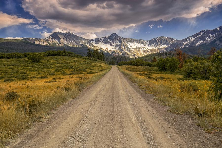 Dirt Road Towards Mountains in Colorado