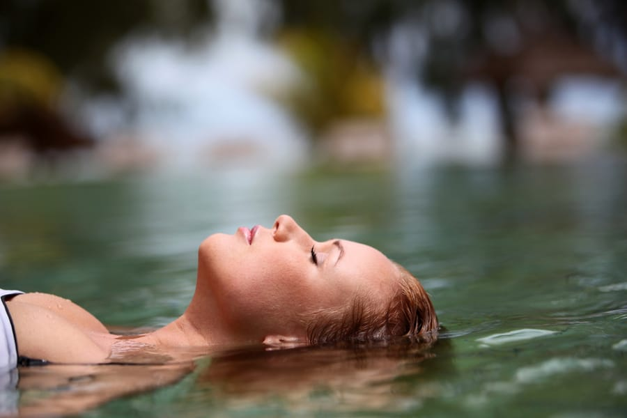 Woman Soaking in Idaho Hot Springs Spa