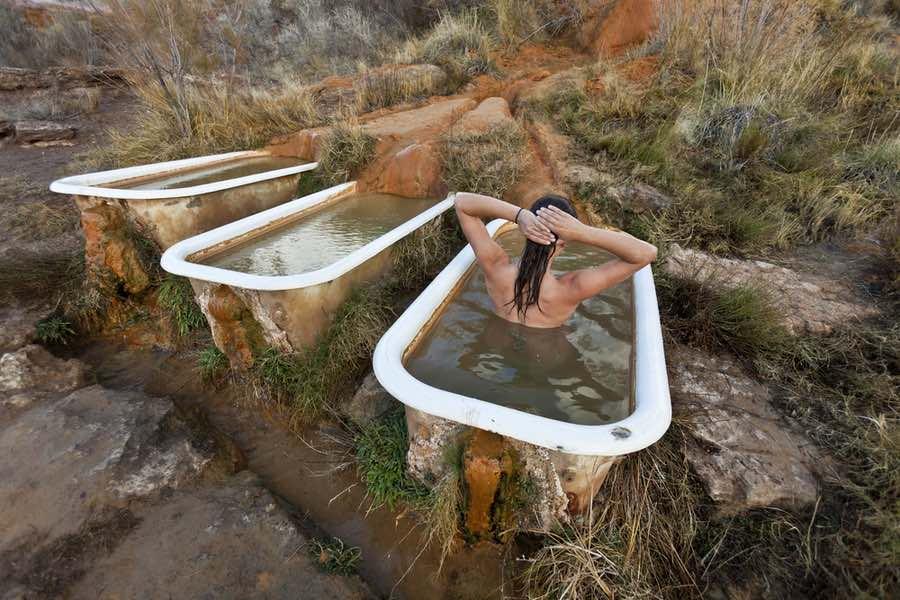 Woman Bathing in Mystic Natural Hot Springs in Utah