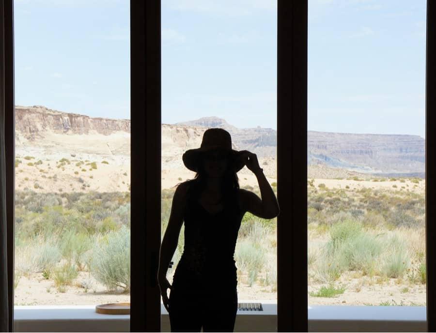 Woman Standing in Front of Window Overlooking Hot Springs in Utah