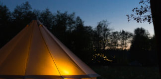 Glamping Tent at Dusk Illuminated from Inside