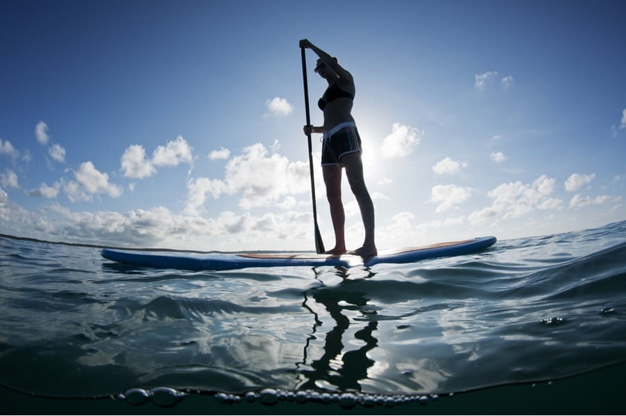 Woman Stand Up Paddleboarding on Ocean