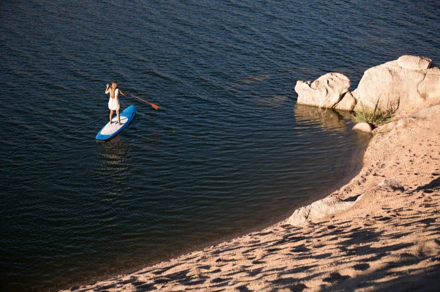 Woman On SUP Near Shore