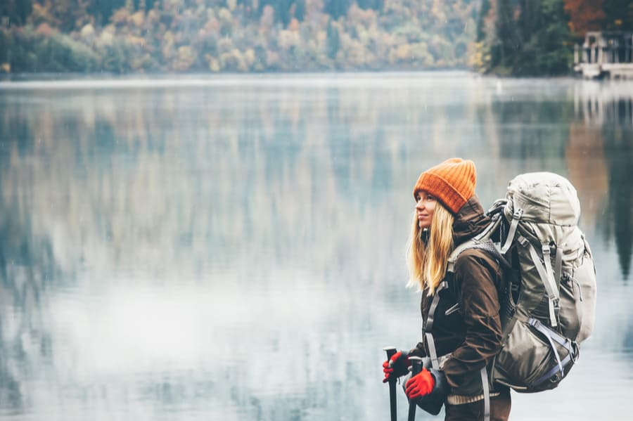 Woman Backpacking in the Winter