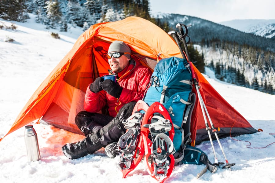 Backpacker in Tent with Snowshoes