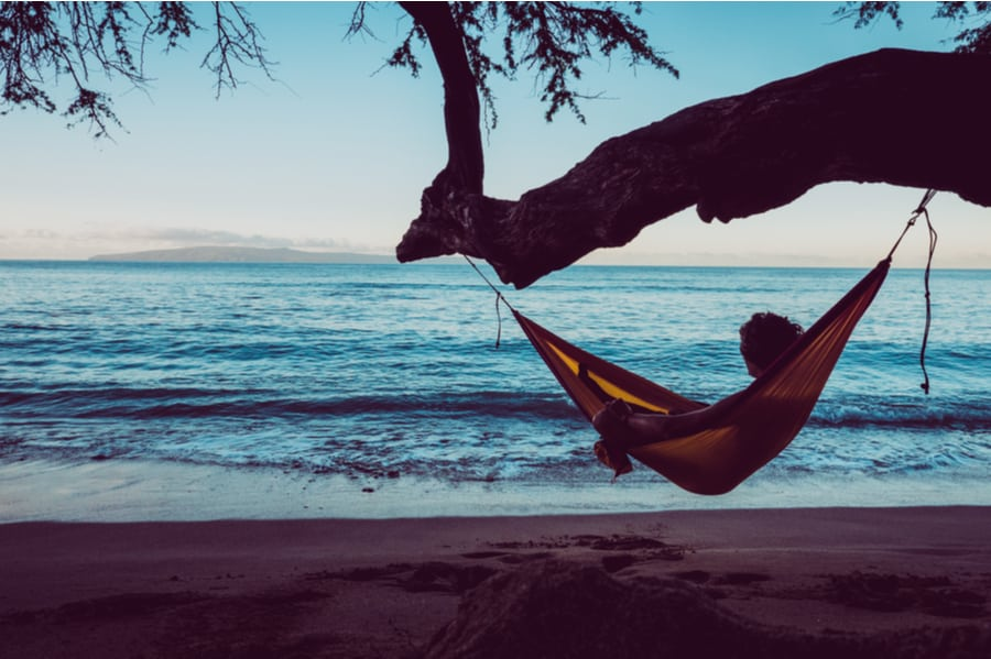 Person Laying in a Camping Hammock Near the Ocean