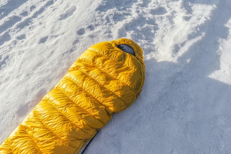 Yellow Winter Sleeping Bag on Snow