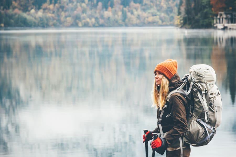 Woman Winter Backpacking Near a Lake