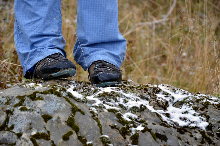 Winter Hiking Boots on Snowy Rock