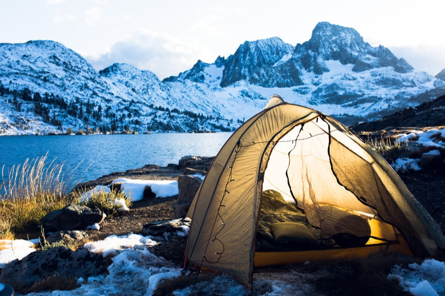 A Camping Tent in Winter with Mountains in the Background