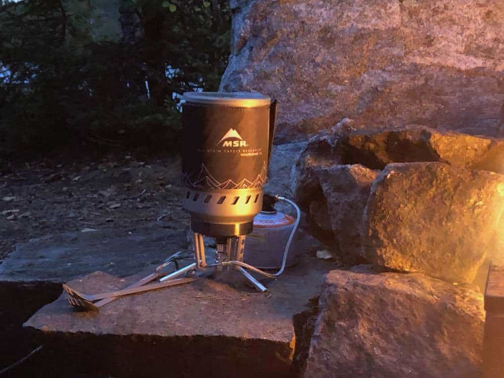 The MSR Windburner DUO camping stove of 1.8L pot at night by a campfire