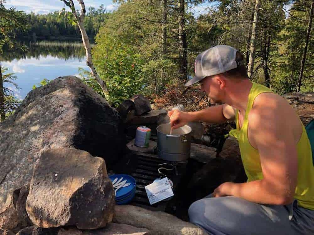 Ryan cooking in the Boundary Waters