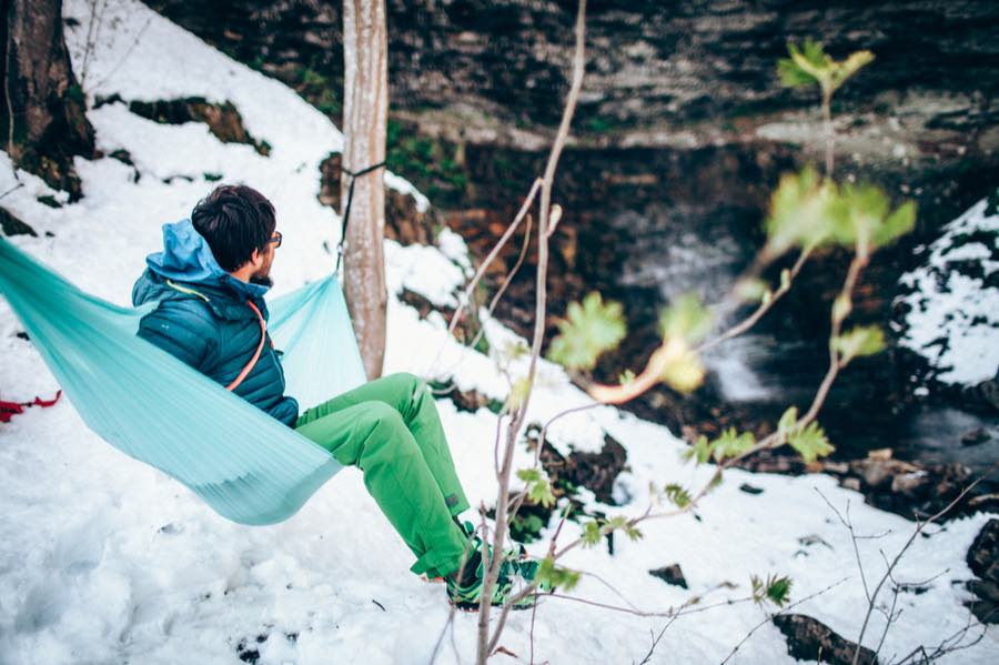 Man in Hammock in Winter Snow