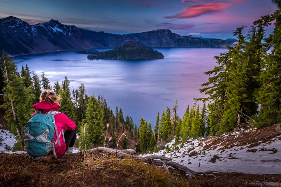 Hiker Looking Out Over Crater Lake National Park