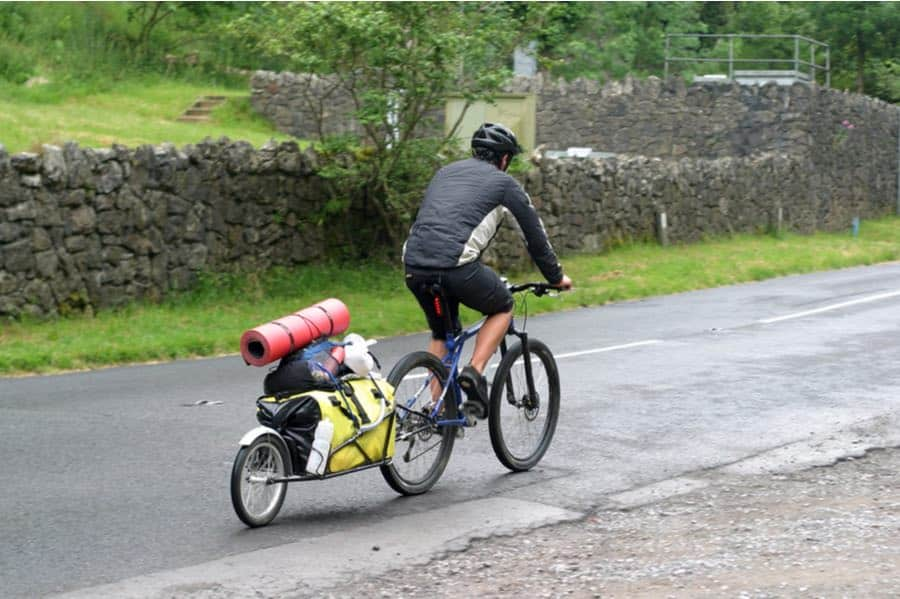 Cyclist Pulling a Bike Camping Trailer