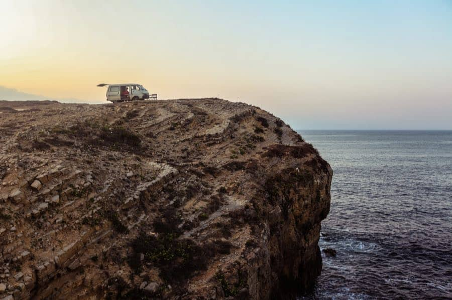 Van Camping on a Cliff Overlooking the Ocean